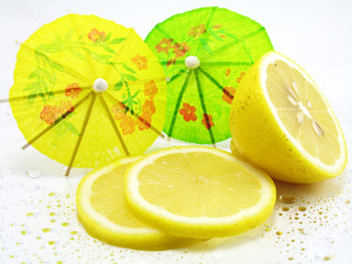 Sliced and Halved Lemons decorated with cocktail umbrellas