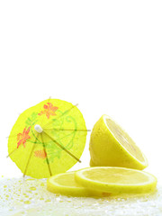 Sliced and Halved Lemons decorated with yellow cocktail umbrella