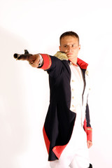 guard in full-dress uniform aiming gun