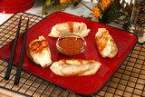 Asian dumplings and peanut dipping sauce. poster