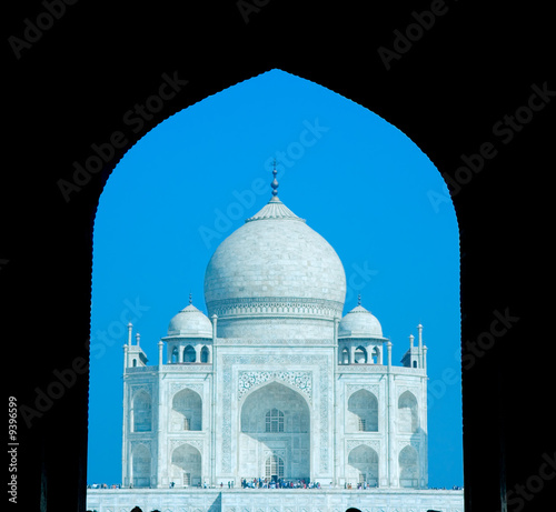 taj mahal in soft early morning light with blue sky..