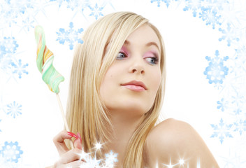 picture of blond girl with big lollipop and snowflakes
