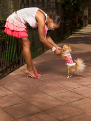 African-American woman with smiling small Pomeranian Spitz dog