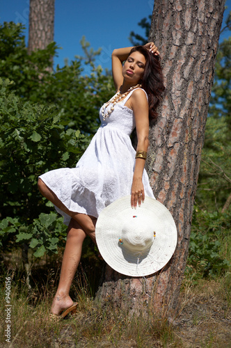 20-25 years old beautiful woman wearing hat, at outdoor