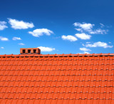 red roofing-tiles with cumulus clouds above poster