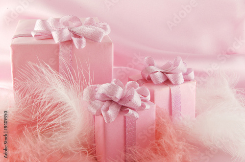 Three pink boxes wiht gift on the pink background