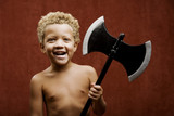Young shirtless boy with a toy hatchet poster