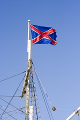 Flag of Russia Navy on a mast in a sunny day
