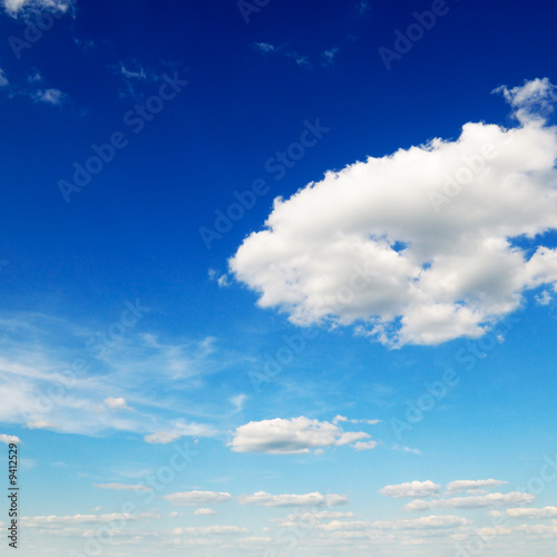poster of blue sky is covered by white fluffy clouds
