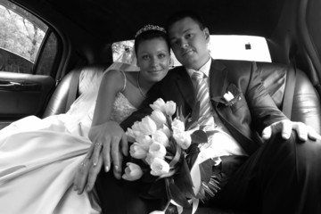 Newly-married couple in car