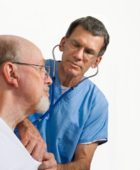 Male Doctor or Nurse Examining Older Man