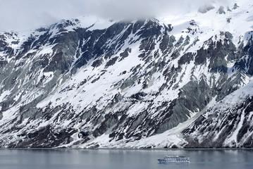 Small ship passing by in Glacier Bay national park, Alaska.