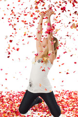 The nice girl covered with petals of roses, isolated on white
