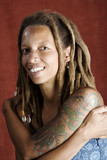 Pretty African American Woman with Hair in Dreadlocks poster