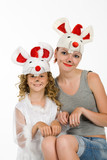 Young woman and little girl in carnival wig poster