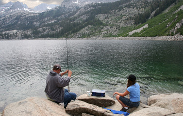Father and daughter fishing in a High Sierras lake
