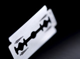 razor blade, very thin depth of field poster