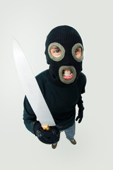 Gangster wearing black balaclava with knife in hand