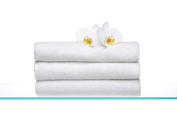 Fresh Towels with white Orchids on glass