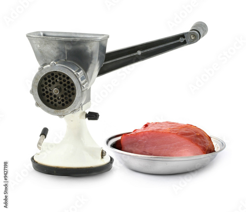 manual mincer and juicy loin on white background