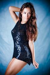 beautiful brunette dancing, studio shot