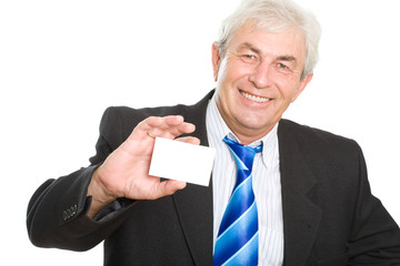 Senior businessman with his card on a white background