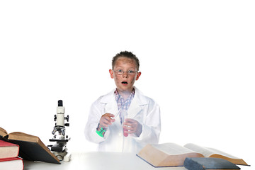 child scientist blowing something up with his test tube