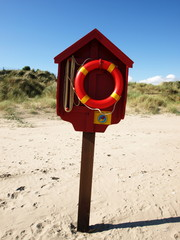lifebuoy in the sandy beach