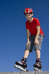 boy on the rollerblades, blue sky background