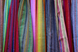 Background of colorful scarfs in a crafts market poster