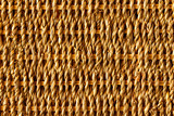 Background of rustic interlaced straw of a handmade craft poster