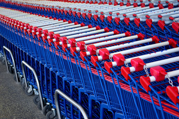 Detail of a rows of supermarket karts tidy put together.