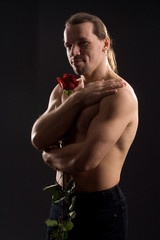 standing romantic man with red rose.