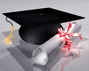 Mortar board and diploma tied with a ribbon