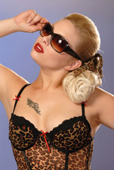 burlesque pretty blonde girl in sunglasses