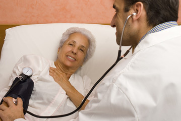 Doctor measuring blood pressure. of senior patient