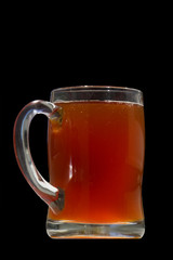 mug of kvass isolated on black