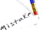 "closeup of a pencil erasing a ""mistake"""