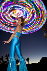 Hoop dancer performing with her LED illuminated hoop.