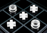 Glass tic-tac-toe game on black background poster