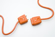 Two Orange Electric Plugs