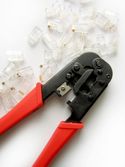 wire stripper and connectors on white