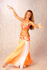beautiful long hair blonde woman in arabic dance costume