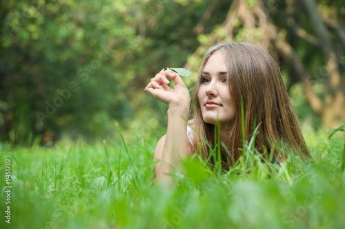 Young woman lying at grass