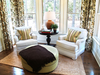 Two comfortable overstuffed chairs in a luxury sunroom