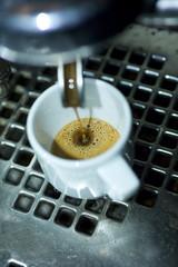 antique italian espresso machine filling a caffe small white cuo
