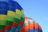 Closeup of two vibrant hot air balloons. poster