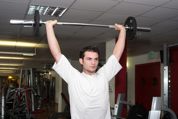 Sportsman with weight at gym