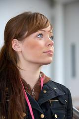 Teenage girl in modern building, looking away