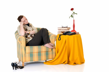 Attractive middle aged woman at home in sofa,